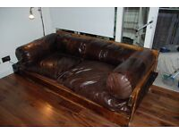 Leather Sofa/Day Bed with wood frame & down filled leather cushions and 4 large bolsters .