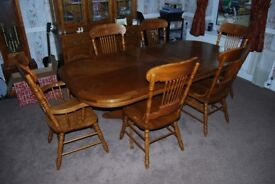 large oak dining room table and chairs.