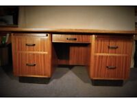 Large, solid wood office desk - with two drawers each side, one in centre