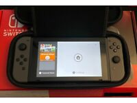 Nintendo Switch Grey Joycon V2 model with 2 games