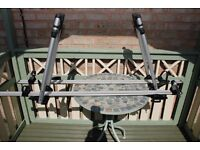 Pair of Bicycle carriers to fit vehicle roof bars.