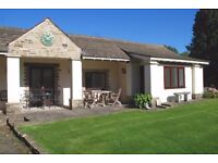 A superb two bedroom furnished bungalow style apartment 4 miles from the city with off road parking