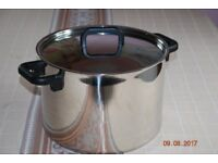 Polished stainless steel stock or soup pot in very good condition.