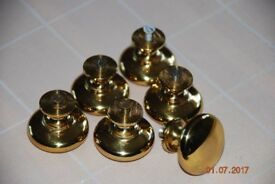 Six solid polished brass cupboard knobs (reduced for quick sale).