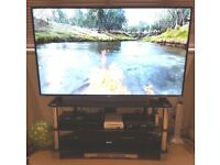 Tv stand - Black tainted glass with crome stands.