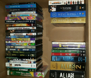 Lot of DVD movies and TV shows. Mixed. $20