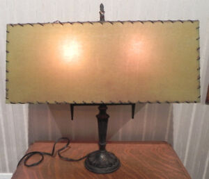 VINTAGE CAST IRON TABLE LAMP WITH PARCHMENT SHADE CIRCA. 1930's