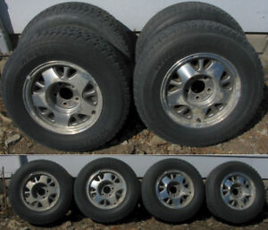 4 - 215/75R15 Arctic Claw Winter TX-i Snows on Aluminum Mags