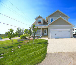 Meticulous Regina Beach home with two garages