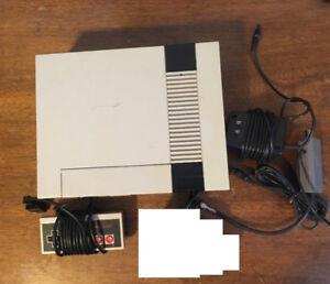 Nintendo Nes avec 4 jeux