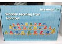 Wooden alphabet learning train