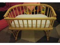 Babybay bedside cot with 2no mattresses and 3no sheets