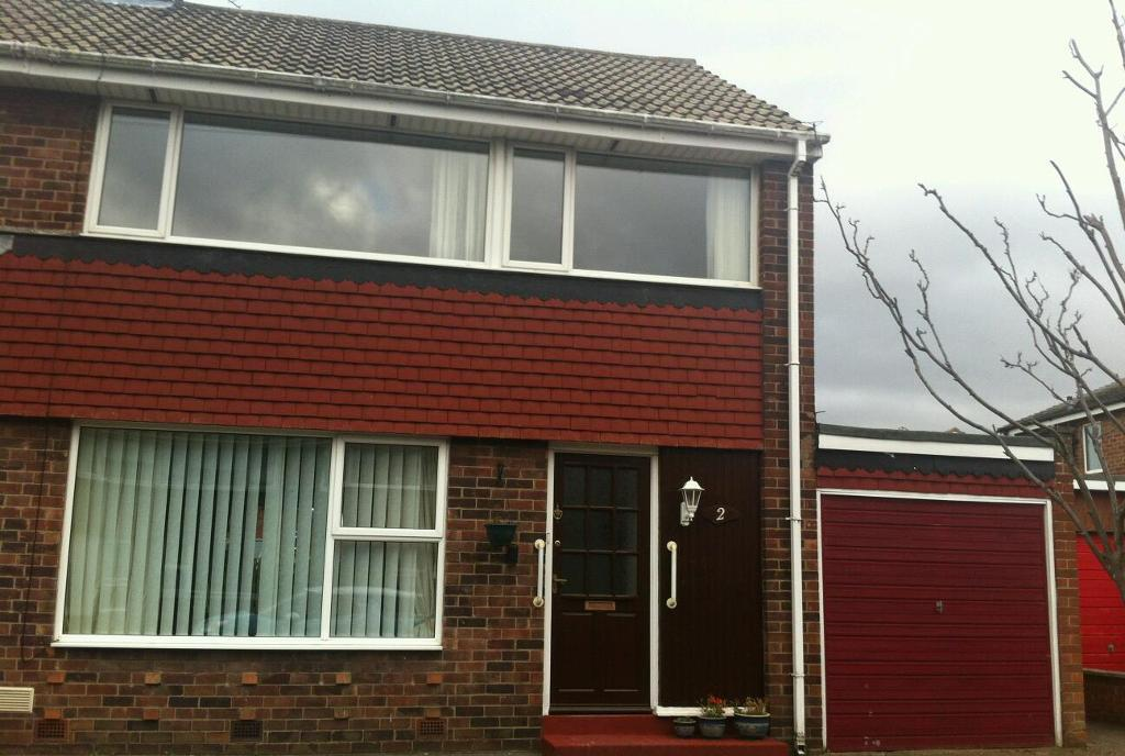 3 bed semi detached property with large garage and gardens