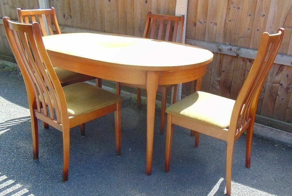 vintage retro 60`s 70`s extendable teak dining table and four matching chairs