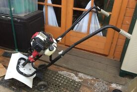 An Eckman 42.2cc two stroke rota-tiller in excellent condition, Hardly used, due to disablement