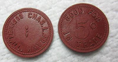 TWO 2 TOKEN -  BUSHNELL IL ILL ILLINOIS - CHAS L. FRANK GF 5c TRADE - RED FIBER