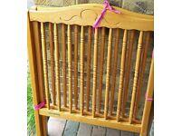 Beautiful Mamas and Papas (M&P) wooden baby's cot with Mamas & Papas spring interior cot mattress.