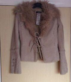 Designer coat unworn, stored in a smoke free house