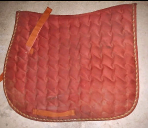 Three English saddle pads