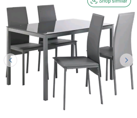 Brand new grey glass dining table and 4 chairs