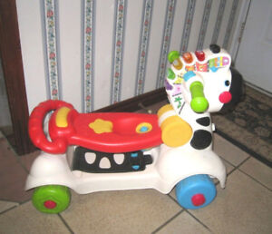 Used VTech 3-in-1 Learning Musical Zebra Scooter, great conditio