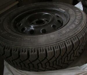 Four Goodyear Nordic winter tires  P195-70-R14.