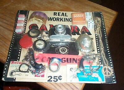 Vintage gumball machine display card 25c toys mini pistol camera etc. dc6