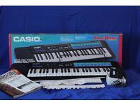 Casio Keyboard with pre-set tones, auto-rhythms, auto accompaniment and tempo controls