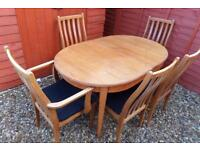 Extending Table with 5 Chairs.