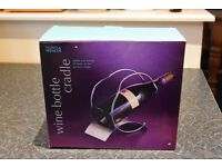 M&S Wine bottle cradle, never used, in original box. Immaculate.