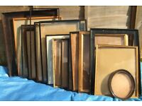 Collection of up to thirty antique & modern picture frames & glass