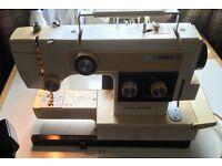 Sewing machine combi new home overlocker.