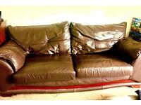 Large leather effect brown settee