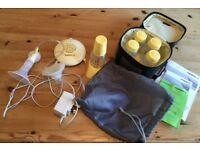 Medela Breast Pump with extra bottles