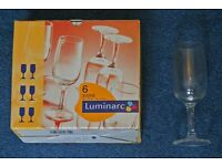 A box of 6 Luminarc small wine glasses new and boxed.