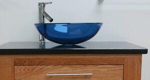 bathroom blue glass basin sink and chrome tap