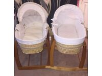 X2 Unisex Moses baskets with mattresses and rocking stands.