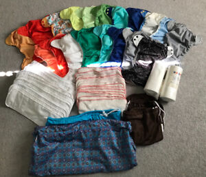 Large lot of Bum Genius cloth diapers, inserts and wet sacs