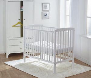 White wood crib with very new mattress