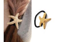 2 New women's gold starfish hairbands