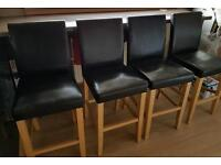 4 black leather effect bar stools