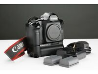 Canon 5D Full Frame Digital Camera with BG-E4 Battery grip and four batteries.