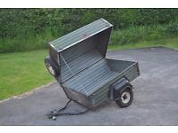 Camping trailer with hinged lid