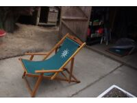 2 deck chairs, green fabric