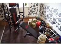 assorted weight plates, bars and bench in good used condition.