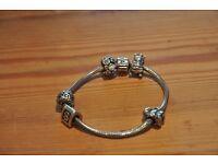 Pandora bracelet and 5 charms