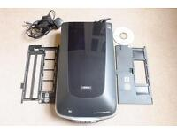 """Epson V500 photo scanner. In """"as new"""" condition. Complete with film masks and software."""