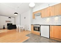 Modern two bedroom warehouse conversion (includes flatscreen HD TV) located in trendy Shoreditch, E2