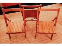 Three vintage folding chairs