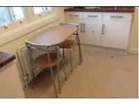 Table and two chairs Rrp £60